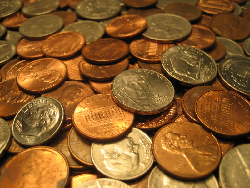 Assorted United States coins 800x600 Fund Fees: Slash Them Early